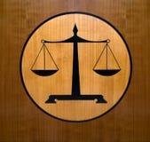 rättvisa skalar symbol Arkivfoto