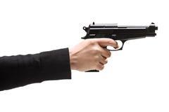 Räuber, der ein Gewehr hält Stockfotos