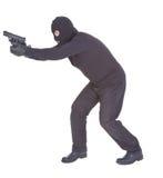Räuber, der mit seiner Gewehr zielt Stockbilder