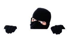 Räuber, der unter einer Wand sich versteckt Stockbilder