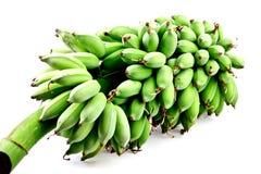 Rå banan som isoleras in på vit Fotografering för Bildbyråer
