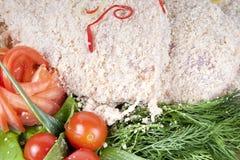 Rå bröad köttkotlett Fotografering för Bildbyråer