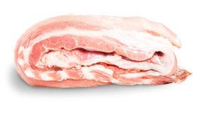 Rå grisköttstöd på en rulle som ligger på dess sida Fotografering för Bildbyråer