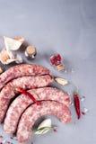 Rå korv med kryddor Royaltyfri Foto