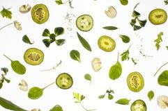 Rå nya ingredienser på vit bakgrund Royaltyfria Foton