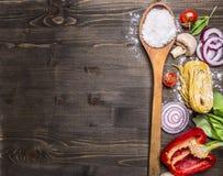 Rå pasta med tomater, basilika, parmesan och olja som lagar mat ingredienser på lantlig träbakgrund, bästa sikt, ställe för text royaltyfria foton