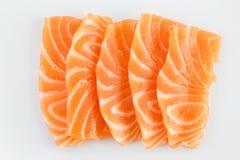 Rå sashimi för lax på vit Arkivbilder