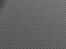RÅ textur för kolfiber Arkivbilder