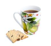 Råna av te med kakor Arkivfoton