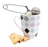 Råna av te med kakor och filtert Royaltyfria Bilder