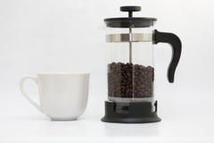 Råna och kaffekrukan royaltyfria foton