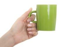 Rånar hållande kaffe för den kvinnliga handen Arkivbilder