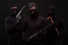 Rånare med geväret Royaltyfria Bilder