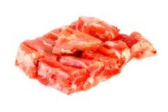 Rått av grisköttstöd på vit Royaltyfri Bild