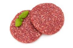 Rått nytt hamburgarekött som isoleras på vit royaltyfria foton