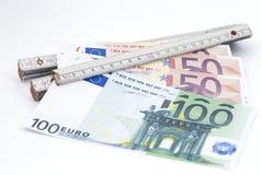 Règle de pliage avec l'argent image libre de droits