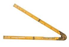 Règle de pliage du charpentier de 19ème siècle avec le niveau en laiton image stock