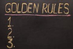 Règles d'or - sur le tableau noir avec la craie Image stock