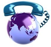 Récepteur téléphonique et globe de la terre. Images libres de droits