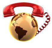 Récepteur téléphonique sur le globe brillant de la terre d'or. Photographie stock