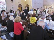 Réception des paroissiens pour la communion Images libres de droits
