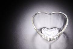 Récipient en verre de forme de coeur Images stock
