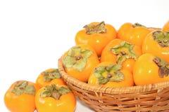 Récolte de fruit de kaki Images libres de droits