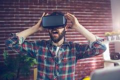 Rédacteur choqué portant des lunettes de la vidéo 3D Photographie stock libre de droits