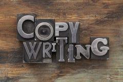 Rédaction publicitaire dans le type blocs en métal Image stock