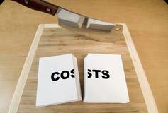Réduction des coûts Images libres de droits