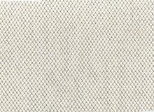 Réduisez le filet d'un pêcheur La texture de la toile, tissus, a gravé le carton en refief, papier de luxe Photo libre de droits