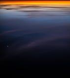Réflexion colorée abstraite de coucher du soleil Photographie stock