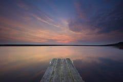 Réflexion de coucher du soleil de jetée Photos libres de droits