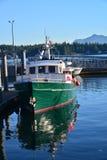 Réflexions de bateau de pêche Photos stock
