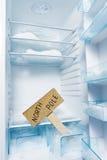 Réfrigérateur avec le gel et le signe de Pôle Nord. Photos libres de droits