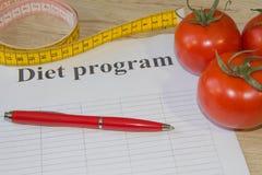 Régime d'aliment biologique naturel sain, composition mûre en fruit de récolte, bande de mesure, calculatrice Suivez un régime le photo stock