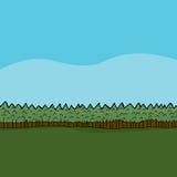 Région boisée avec le pâturage vert Photographie stock