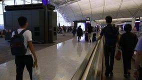 Région de embarquement de passager en Hong Kong International Airport Voyage de personnes banque de vidéos