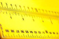 Réguas amarelas dos taylors Fotografia de Stock Royalty Free