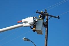 Réparation de ligne électrique photo stock