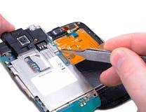 Réparation de téléphone portable Photographie stock libre de droits