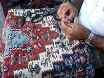 Réparation de tapis Photographie stock libre de droits