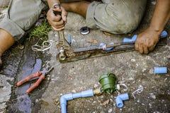 Réparation de tuyauterie photographie stock