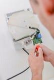 Réparation du dessiccateur d'expert photo stock