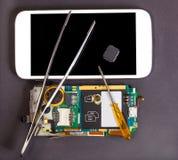 Réparation et entretien des périphériques mobiles Image stock