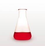 Réplica del triángulo con el líquido rojo foto de archivo libre de regalías