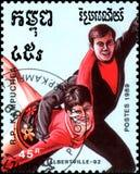 RÉPUBLIQUE DU KAMPUCHEA CAMBODGE - VERS 1989 : le timbre-poste, imprimé dans la République du Kampuchea, montre une paire de pati Photographie stock libre de droits