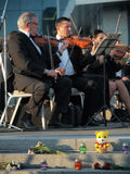 Réquiemes para las víctimas del vuelo MH17 Orquesta sinfónica de Kharkov Foto de archivo libre de regalías