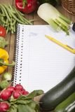 Réservez entouré avec la variété de légumes Photos libres de droits