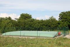 Réservoir de stockage gonflable rural de l'eau Photographie stock libre de droits